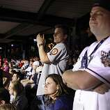 Giants fan Bryant Davis (left) of Los Angeles and Rangers fan Craig Nelson of Plano, Texas, react after Buster Posey's home run in the eighth inning of Game 4 of the World Series at Rangers Ballpark on Sunday.