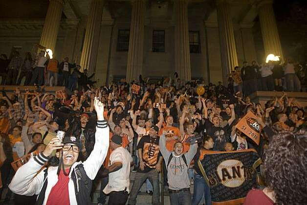 Giants fans celebrate on the steps of the Old Mint on 5th Street after the Giants defeated the Texas Rangers to win the World Series in 5 games on November 1, 2010 in San Francisco, Calif. Photo: Douglas Zimmerman, Courtesy To The SF Gate