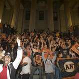 Giants fans celebrate on the steps of the Old Mint on 5th Street after the Giants defeated the Texas Rangers to win the World Series in 5 games on November 1, 2010 in San Francisco, Calif.
