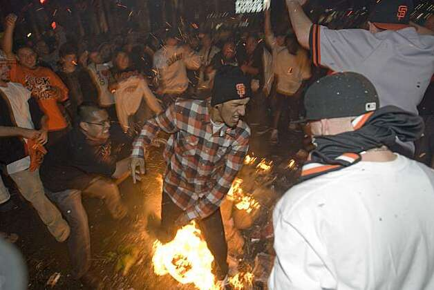 Giants fans celebrate the World Series win around a bonfire in the street at the intersection of 3rd Street and King Street in San Francisco, Calif., on Monday, November 1, 2010. Photo: Douglas Zimmerman, Courtesy To The SF Gate