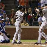 San Francisco Giants center fielder Andres Torres greets Aubrey Huff at the plate after scoring on Huff's two-run homer in the third inning of Game 4 of the World Series on Sunday.