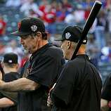 Manager Bruce Bochy (left) and third base coach Tim Flannery during batting practice as the San Francisco Giants prepare to take on the Texas Rangers in Game 4 of the World Series on Sunday.