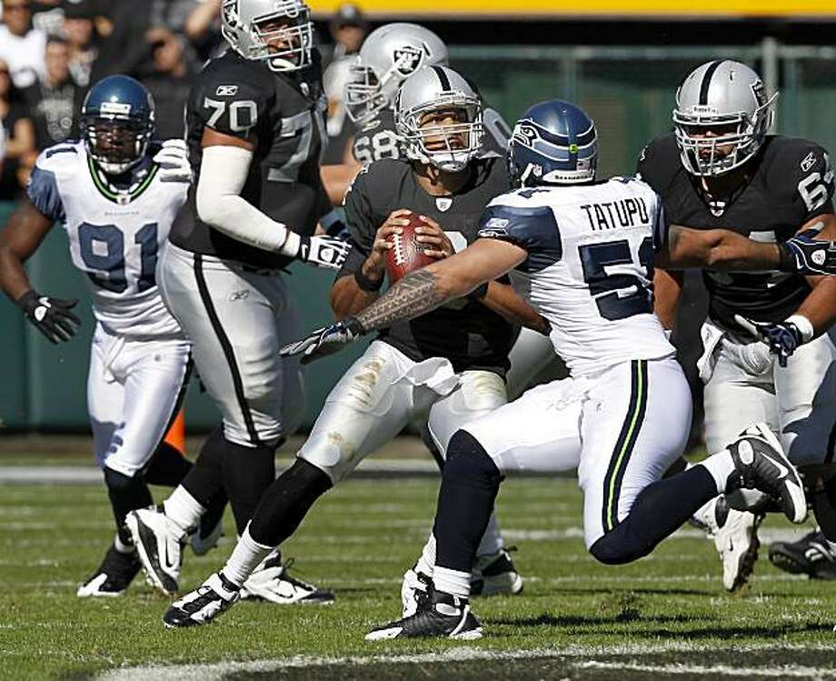 Jason Campbell scrambles for a gain in the first half against the Seattle Seahawks on Sunday at the Oakland Coliseum. Photo: Brant Ward, The Chronicle