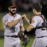 Giants closer Brian Wilson and catcher Buster Posey finsih the ninth inning of Game 4 of the World Series against the Texas Rangers on Sunday.