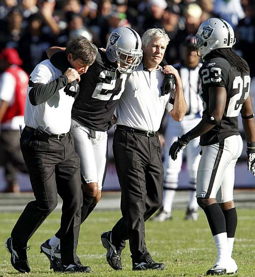 The Raiders' Nnamdi Asomugha is helped off the field in the second half against the Seattle Seahawks on Sunday at the Oakland Coliseum. Photo: Brant Ward, The Chronicle