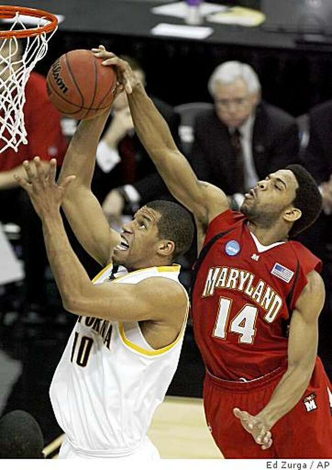 Maryland's Sean Mosley (14) gets a hand on the ball as California's Jamal Boykin (10) tries to make a shot in the first half during a first-round men's NCAA college basketball tournament game in Kansas City, Mo., Thursday, March 19, 2009. Photo: Ed Zurga, AP