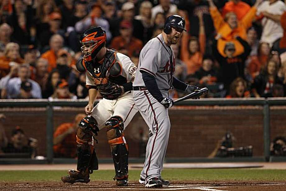 Braves Brian McCann reacts after striking out swinging in the top of the first inning  as the San Francisco Giants take on the Atlanta Braves  in Game 1 of the National League Division Series at AT&T Park in San Francisco, Calif., on Thursday, October 7, 2010. Photo: Carlos Avila Gonzalez, The Chronicle