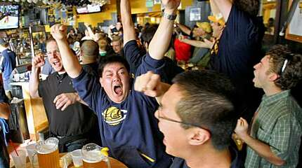 Ryan Mascarinas (center) and Andy Li reacts as he watched the Cal Bears in the  first round of the NCAA Tournament, Thursday March 19, 2009, at the Bear Lair restauant and bar, in Berkeley, Calif.