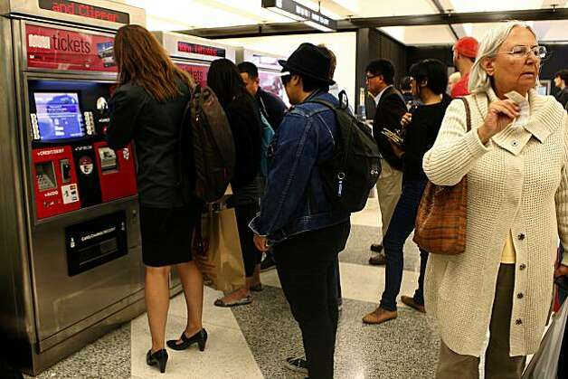 The new Muni Ticket Vending Machines being used by commuters at Powell Street station in San Francisco, Calif., on Thursday, September 9, 2010. Both Muni tickets and Clipper cards can be purchased at the machines, which were installed at Powell Street station a week ago. Clipper is the all-in-one, reloadable fare payment card that can be used on many Bay Area transit systems. Photo: Liz Hafalia, The Chronicle