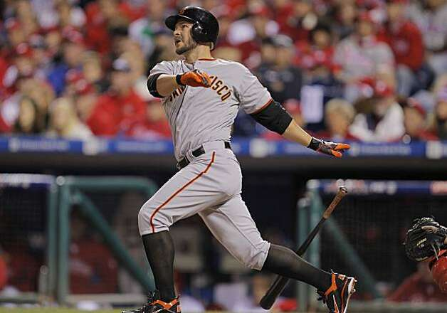 The Giants' Cody Ross hits a solo home run in the third inning of Game 1 of the National League Championship Series on Saturday at Citizens Bank Park in Philadelphia. Photo: Michael Macor, The Chronicle