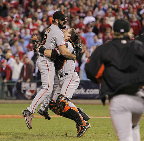 Brian Wilson and Buster Posey celebrate the Giants' victory in Game 6 of the NLCS on Saturday at Citizens Bank Park in Philadelphia. Photo: Michael Macor, The Chronicle