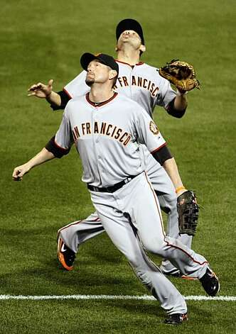 Aubrey Huff is called off a fly ball by Freddy Sanchez, who caught it to retire the Phillies' Shane Victorino in Game 1 of the NLCS at Citizens Bank Park in Philadelphia on Saturday. Photo: Lance Iversen, The Chronicle