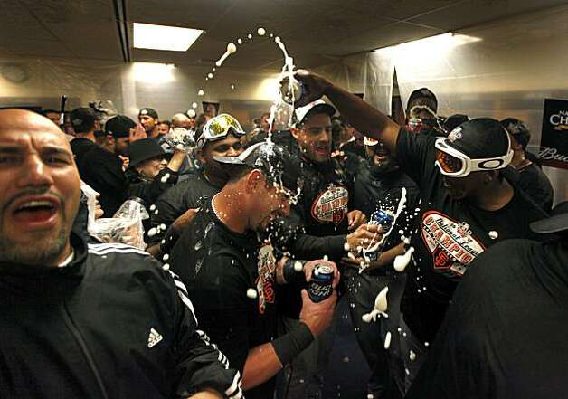 Aaron Rowand of the San Francisco Giants is doused with beer in the locker room after defeating the Philadelphia Phillies 3-2 in Game Six of the NLCS to advance to the World Series during the 2010 MLB Playoffs at Citizens Bank Park in Philadelphia PA Saturday, October 23, 2010. Photo: Lance Iversen, The Chronicle