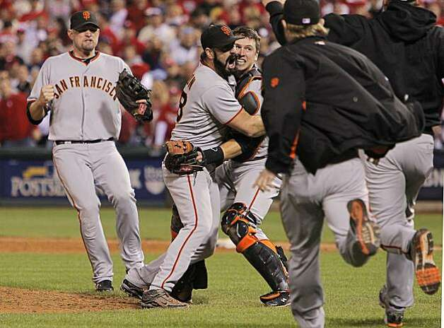 Aubrey Huff (left), Brian Wilson and catcher Buster Posey celebrate the Giants' victory over the Phillies in Game 6 of the NLCS on Saturday at Citizens Bank Park in Philadelphia. Photo: Michael Macor, The Chronicle