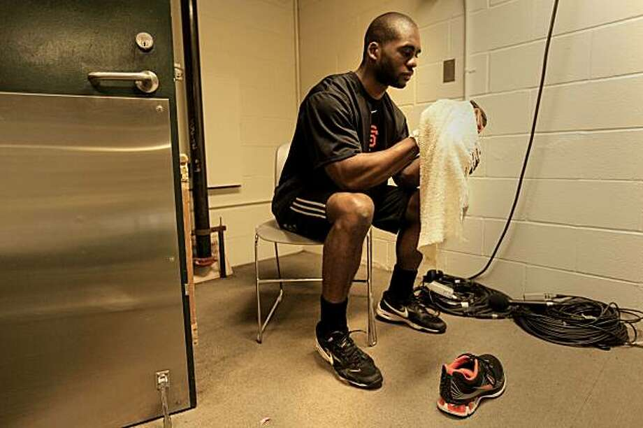 Brandon Evans, who has been a clubhouse attendant for the San Francisco Giants,  cleans the shoes of the players on Wednesday Oct. 20, 2010 at AT&T Park, in San Francisco, Calif. Photo: Michael Macor, The Chronicle