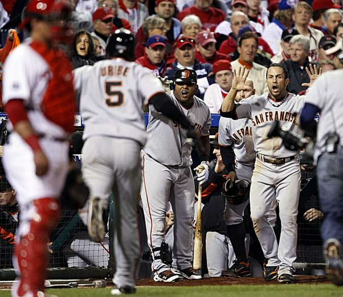 The San Francisco Giants celebrate Juan Uribe's 8th inning home run put the Giants in the lead 3-2 in game six of the NLCS game with the Philadelphia Phillies Saturday Oct. 23, 2010 at Citizens Bank Park in Philadelphia PA.