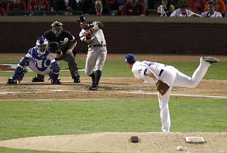 San Francisco Giants center fielder Cody Ross (13) hits a solo homer in the seventh inning of Game 3 of the World Series on Saturday. Photo: Carlos Avila Gonzalez, San Francisco Chronicle