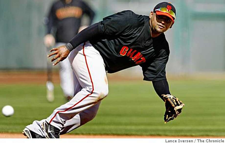 San Francisco Giants Pablo Sandoval runs down a ground ball between 3rd and 2nd bases at Spring Training workouts at Scottsdale Stadium Saturday February 21, 2009 in Scottsdale Arizona Photo: Lance Iversen, The Chronicle