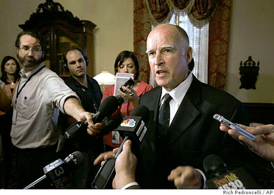 Attorney General Jerry Brown talks to reporters in Sacramento, Calif., Tuesday, Sept. 16, 2008. Gov. Arnold Schwarzenegger remains silent about whether he will sign or veto the state budget lawmakers approved early Tuesday, raising the possibility of a rare override veto in the legislature. The last time lawmakers mounted a successful override was 1979, when Brown was governor.  (AP Photo/Rich Pedroncelli) Photo: Rich Pedroncelli, AP