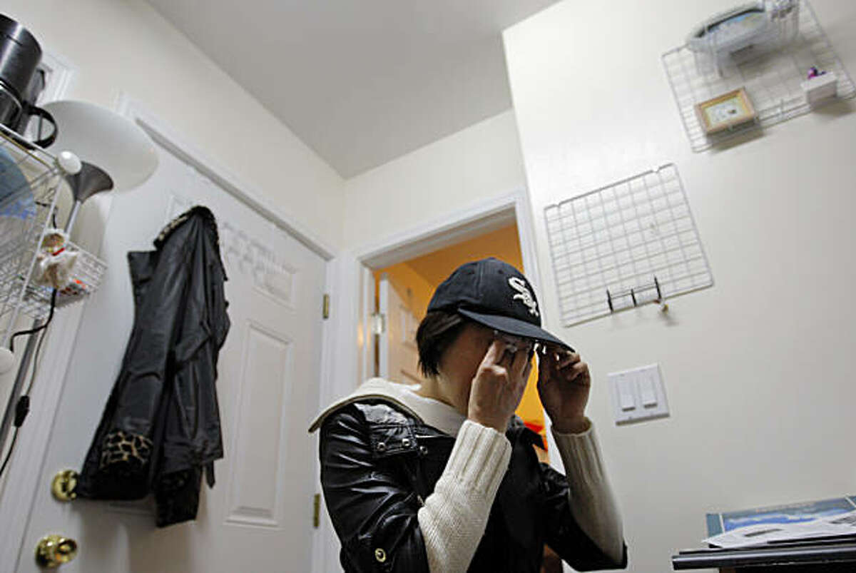 Li Ma wipes tears from her eyes as she talks about her son Steve Li's impending deportation Saturday, October 23, 2010, San Francisco, Calif. Shing