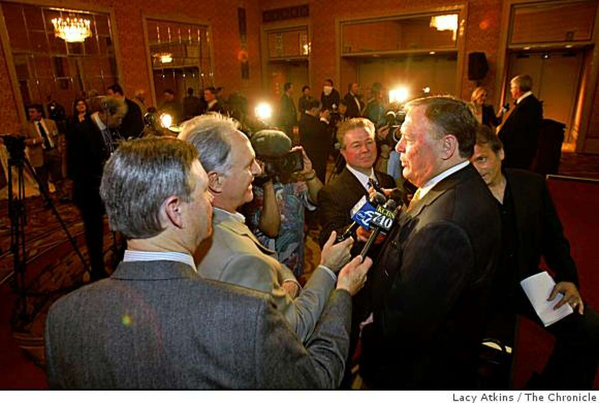 The media surrounds Craig Morton and Dave Casper ( background) to ask questions about being honored by The Bay Area Sports Hall of Fame celebrates its 30 years, Monday March 9, 2009, in San Francisco, Calif.