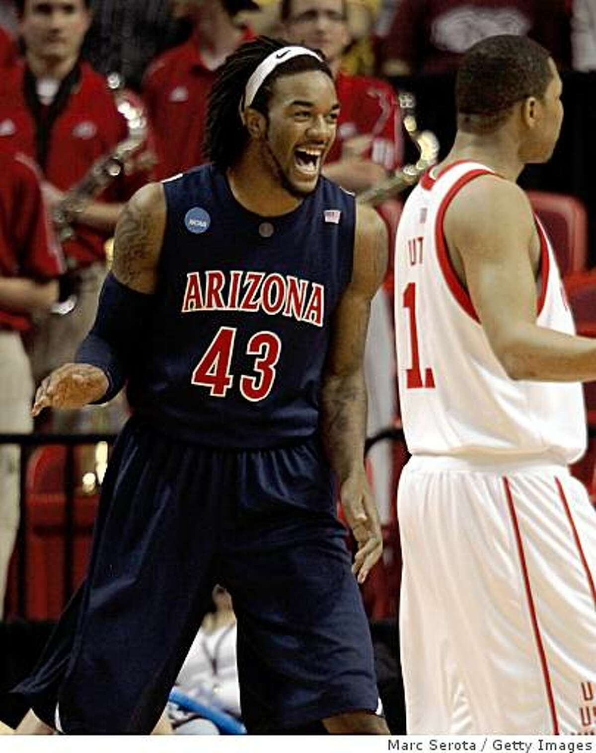 MIAMI - MARCH 20: Forward Jordan Hill #43 of the University of Arizona Wildcats celebrates a three point play over University of Utah Runnin' Utes during the first round of the NCAA Division I Men's Basketball Tournament at the American Airlines Arena on March 20, 2009 in Miami, Florida. (Photo by Marc Serota/Getty Images)