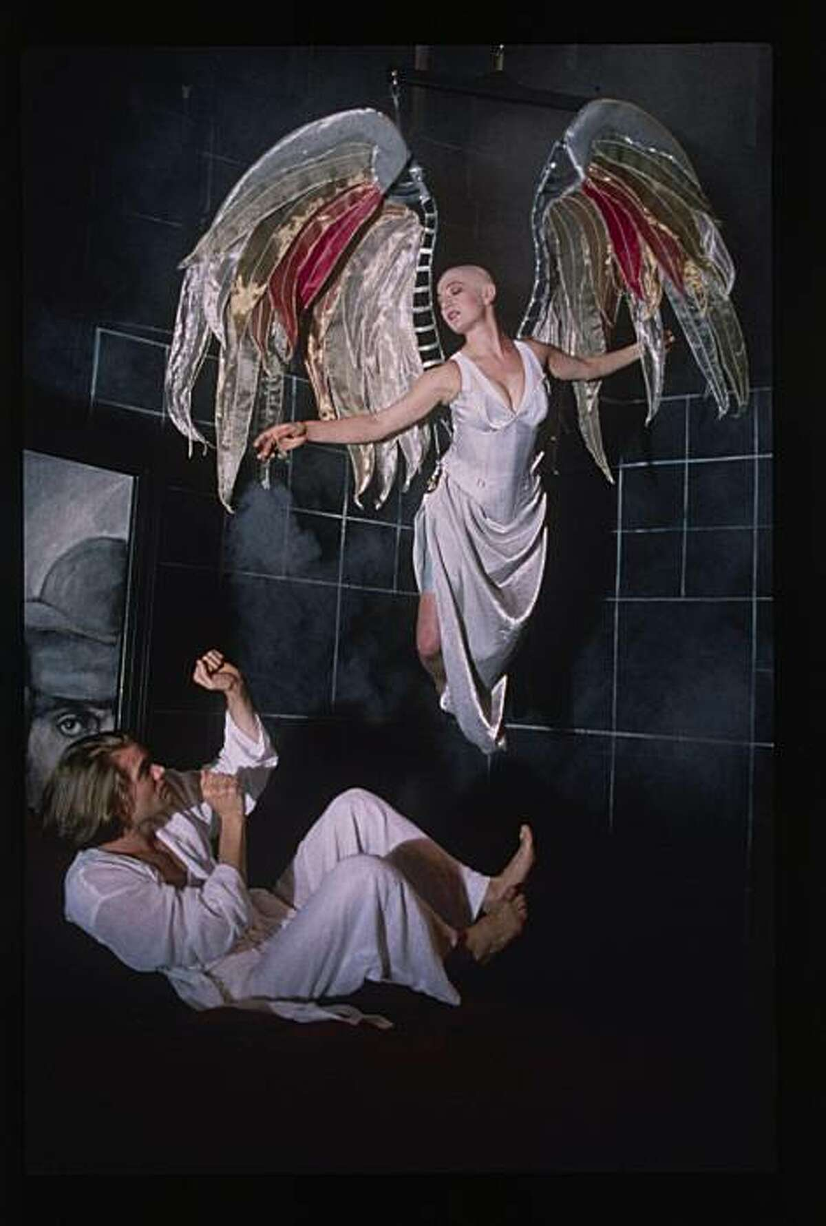 The Angel (Lise Bruneau) appears to Prior (Garret Dillahunt) in Angels in America, American Conservatory Theater, San Francisco, 1994. Credit: Ken Friedman/American Conservatory Theater