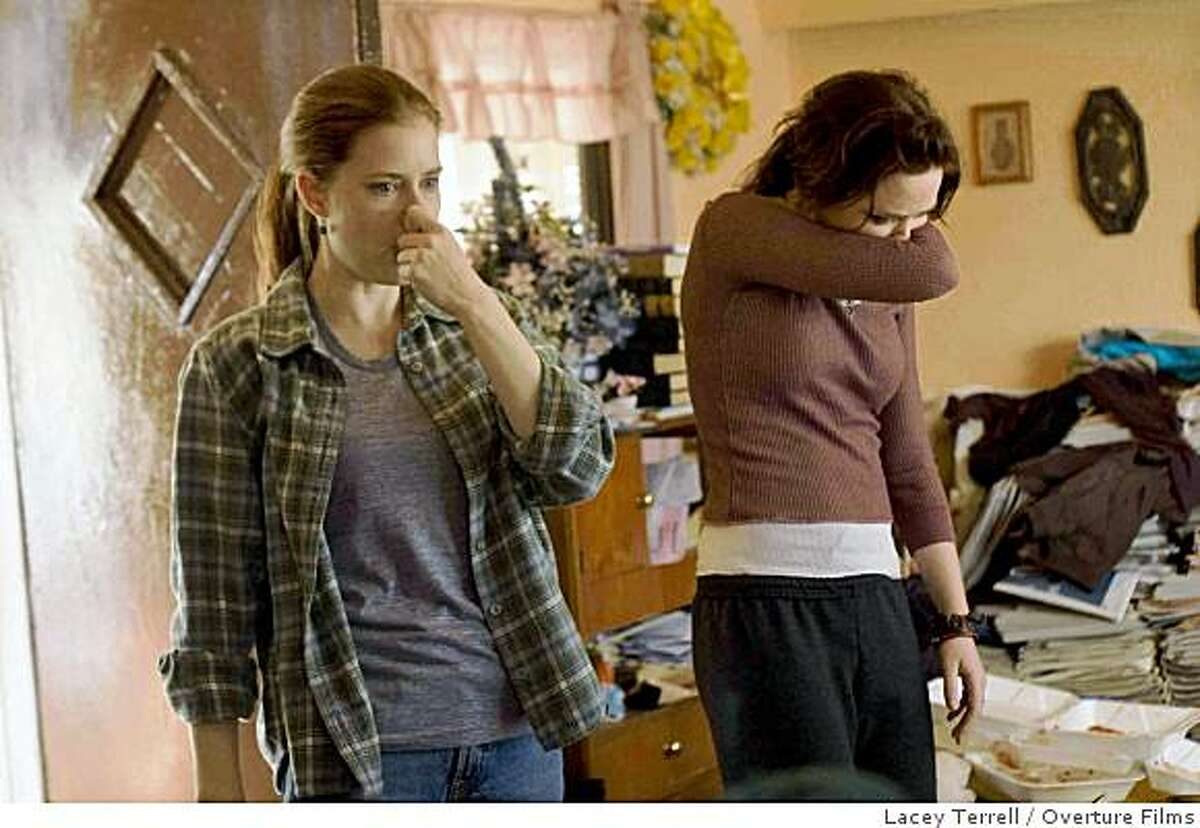 """In this film still released by Overture Films, Amy Adams, left, and Emily Blunt are shown in a scene from """"Sunshine Cleaning."""""""