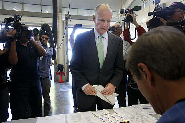 Gubernatorial candidate Jerry Brown checks in with poll workers before voting at Oakland Fire Station No. 6 on Tuesday. Photo: Mike Kepka, The Chronicle