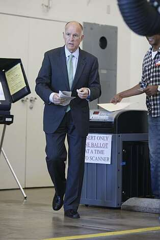 Gubernatorial candidate Jerry Brown walks out of Oakland Fire Station No. 6 after casting his vote Tuesday. Photo: Mike Kepka, The Chronicle