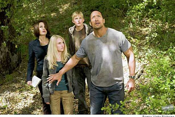 "Carla Gugino, AnnaSophia Robb, Alexander Ludwig and Dwayne ""The Rock"" Johnson in ""Race to Witch Mountain."""