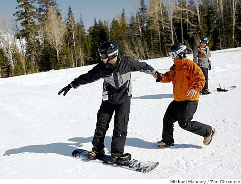 Adaptive Snowsports  instructor Travis Weaver (right) runs after 19 year old veteran Ufrano Rios as he learns to snowboard on the slopes of Alpine Meadows Ski Resort on Wednesday, March 11, 2009. Rios, from Fresno, Calif., was participating in the Disabled Sports USA and the Wounded Warrior Ability Camp. Photo: Michael Maloney, The Chronicle