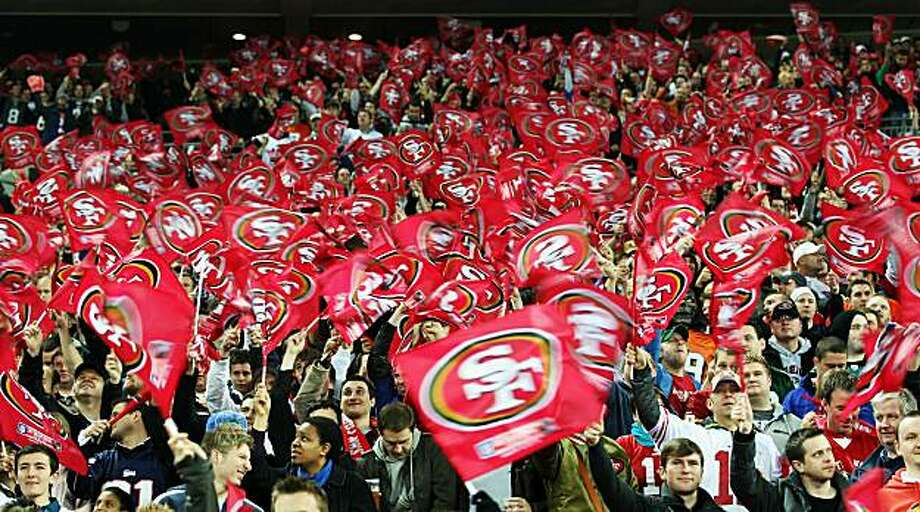 LONDON, ENGLAND - OCTOBER 31:  San Francisco 49ers fans waves flags in support of their team during the NFL International Series match between Denver Broncos and San Francisco 49ers at Wembley Stadium on October 31, 2010 in London, England. This is the fourth occasion where a regular season NFL match has been played in London. Photo: Ian Walton, Getty Images