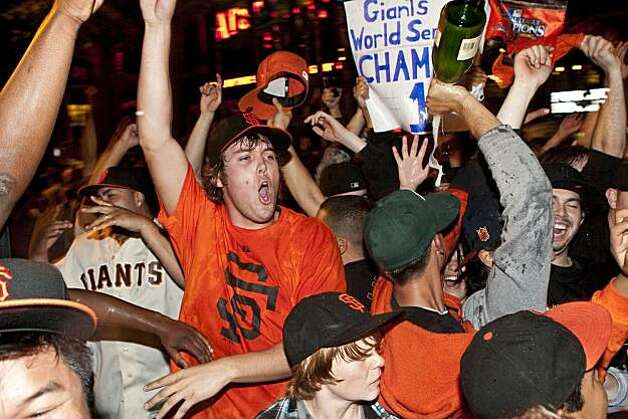 Giants fans celebrate their World Series win outside AT&T Park in San Francisco, Calif., on Monday, November 1, 2010.  The Giants beat the Texas Rangers 3-1 in Game 5 of the World Series. Photo: Laura Morton, Special To The Chronicle