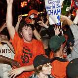 Giants fans celebrate their World Series win outside AT&T Park in San Francisco, Calif., on Monday, November 1, 2010.  The Giants beat the Texas Rangers 3-1 in Game 5 of the World Series.