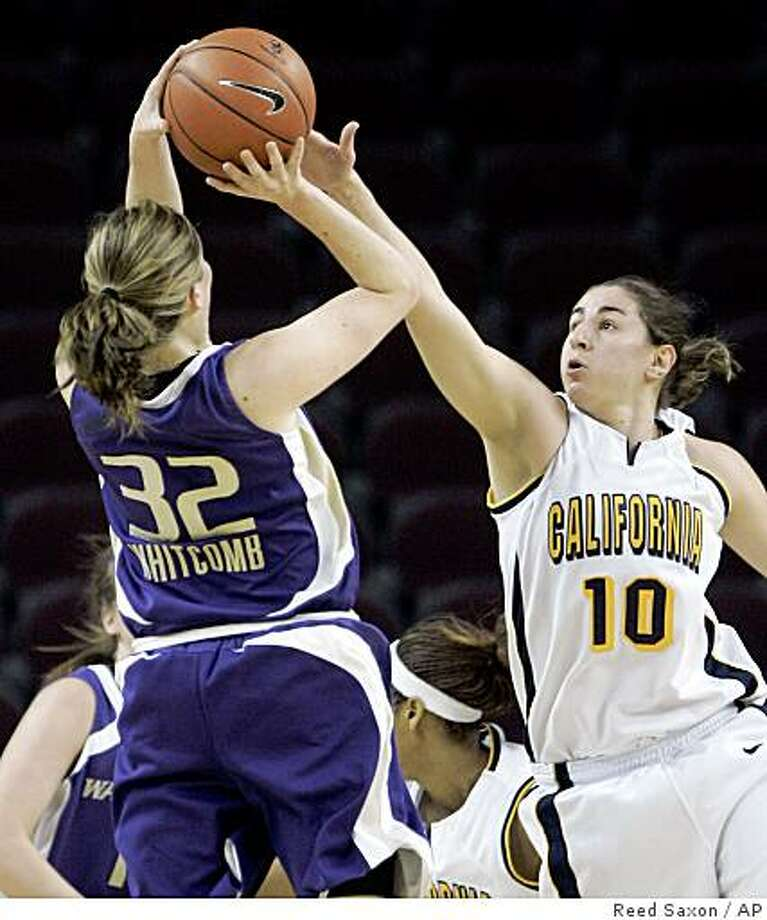 California guard Lauren Greif (10) defends as Washington guard Sami Whitcomb shoots in the first half of an NCAA college basketball game in the Pac-10 women's tournament in Los Angeles Friday, March 13, 2009.  California won, 61-41.  (AP Photo/Reed Saxon) Photo: Reed Saxon, AP