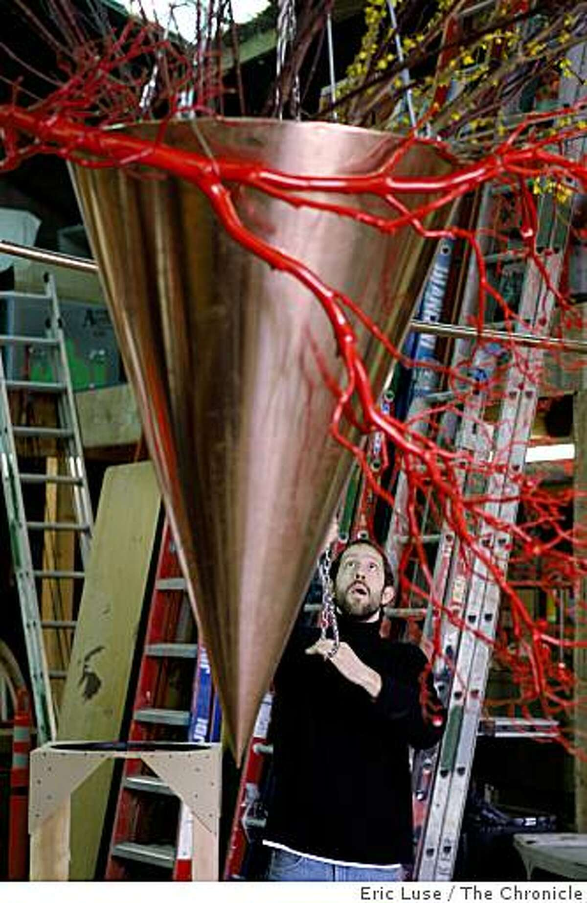 Designer Daniel Schultz is helping with Natasha Lisitsa's very large flower installation being built in a warehouse in South San Francisco for the Bouquet to Arts at the de Young Museum photographed on Tuesday, March 3, 2009.