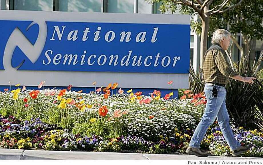 A man walks in front of National Semiconductor headquarters in Santa Clara, Calif., Wednesday, March 11, 2009. Faced with a steep decline in sales, chip maker National Semiconductor Corp. said Wednesday it will eliminate more than one-quarter of its work force, or 1,725 jobs Photo: Paul Sakuma, Associated Press