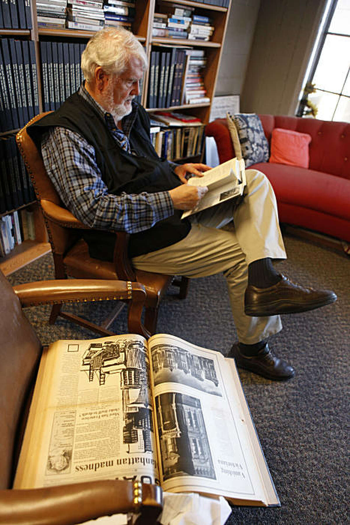 Bruce Brugmann, former owner of the Bay Guardian, flips through a copy of