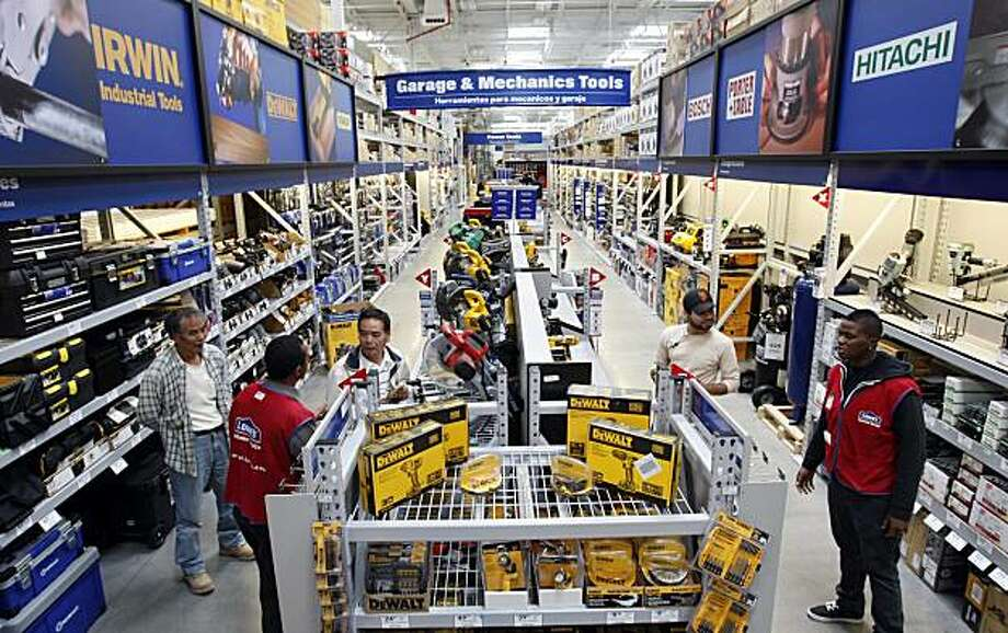 Lowe's employees try to help customers find what they are looking for Friday, October 29, 2010, San Francisco, Calif.  The first Lowe's comes to San Francisco. Photo: Adm Golub, The Chronicle