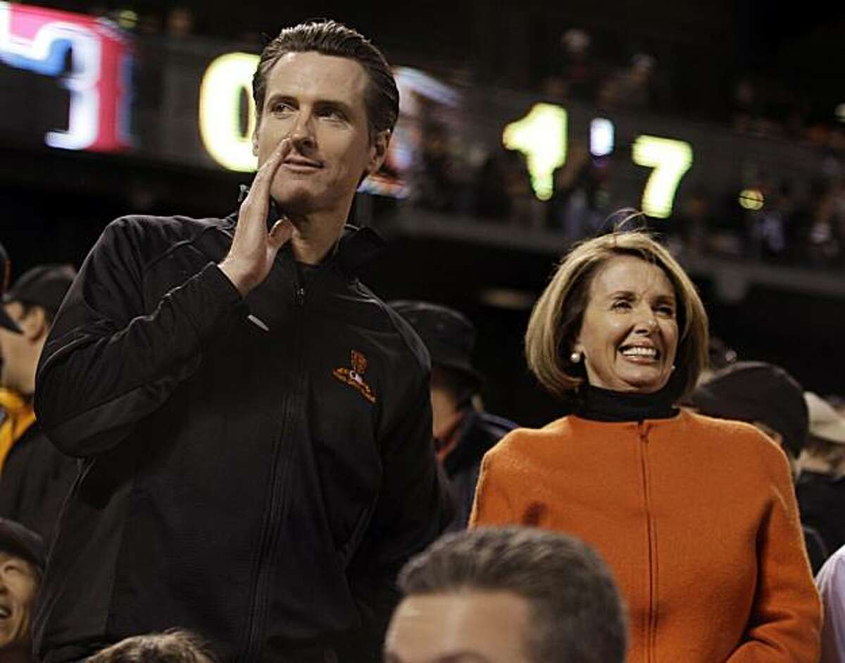 Then-San Francisco mayor Gavin Newsom watches Game 2 of baseball's World Series between the San Francisco Giants and the Texas Rangers with Speaker of the U.S. House of Representatives Nancy Pelosi in 2010.