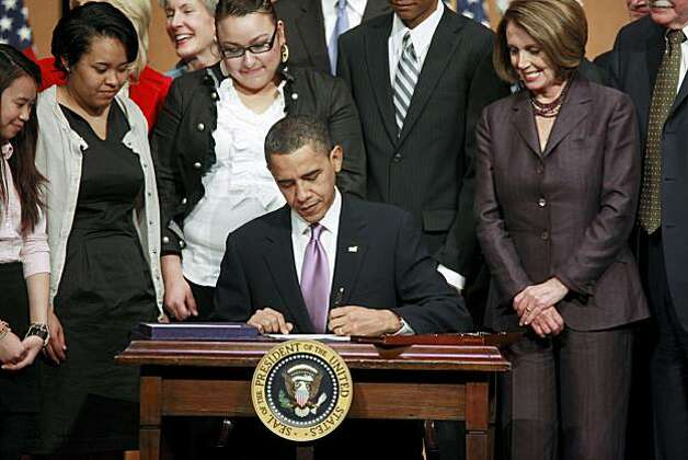 FILE - In this March 30, 2010 file photo, President Barack Obama signs the Health Care and Education Reconciliation Act of 2010, during a ceremony at Northern Virginia Community College in Alexandria, Va. The public panned it. Republicans obstructed it. Many Democrats fled from it. Even so, the session of Congress now drawing to a close was the most productive in nearly half a century. House Speaker Nancy Pelosi of Calif. is at right. Photo: Pablo Martinez Monsivais, AP