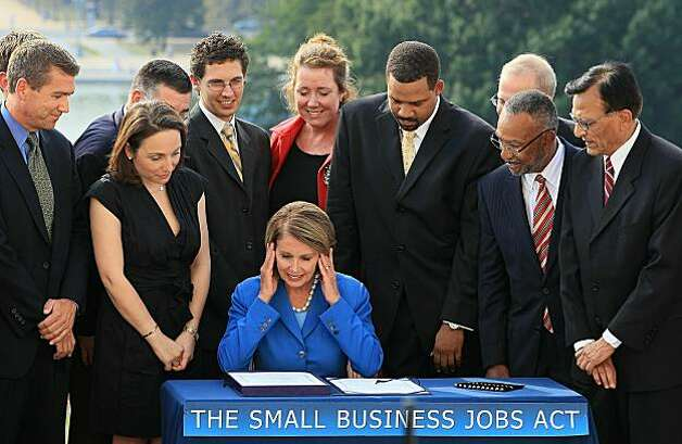 WASHINGTON - SEPTEMBER 23: Surrounded by small business owners, House Speaker Nancy Pelosi prepares to sign the Small Business Jobs Act at the U.S. Capitol on September 23, 2010 in Washington, DC. Today the House of Representatives passed the bill that will provide $12 billion in tax breaks and a $30 billion lending fund to small business enterprises. Photo: Mark Wilson, Getty Images