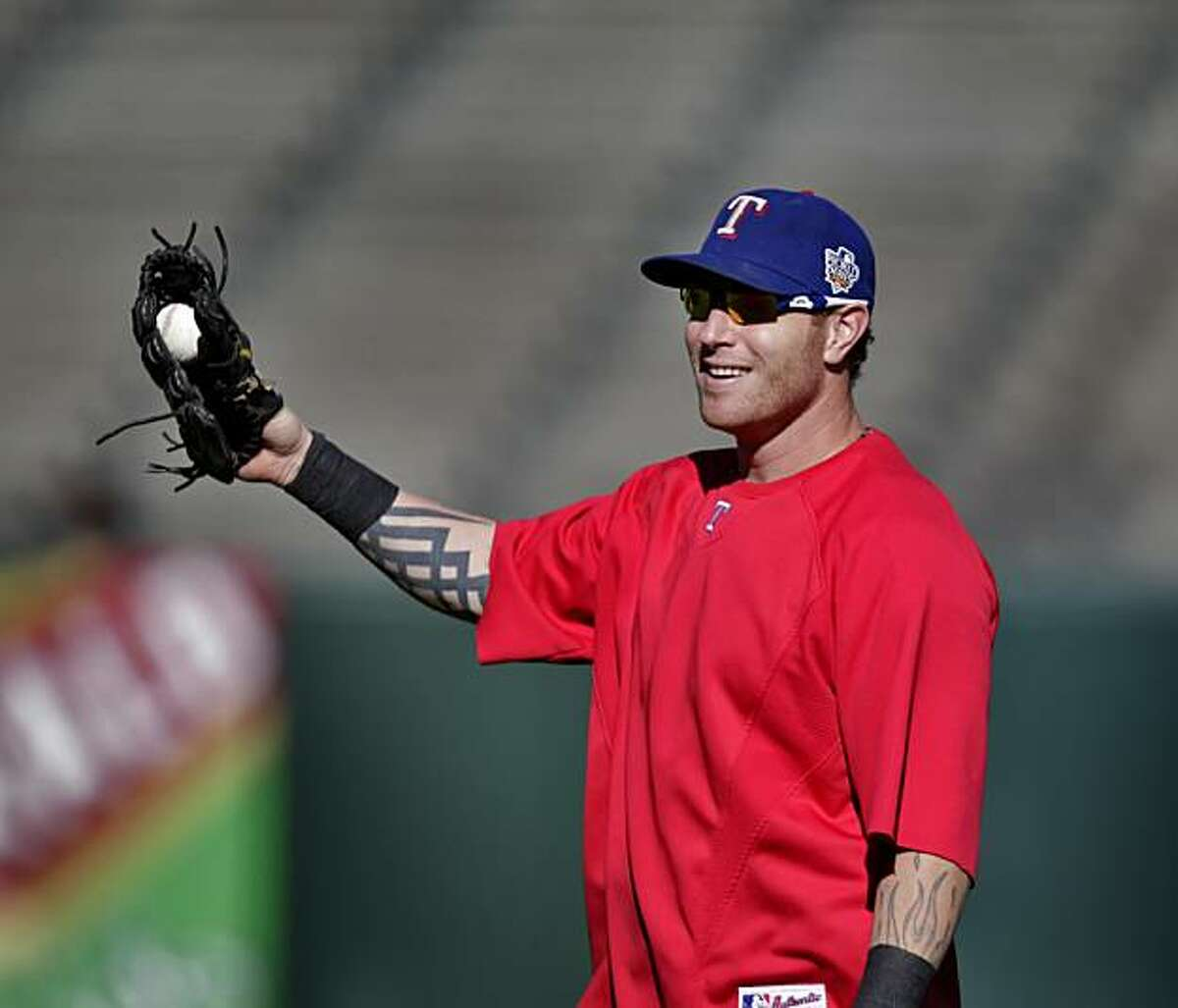 The Texas Rangers outfielder Josh Hamilton warms up during practice, in preparation of the Game 1 of the World Series, Tuesday Oct. 26, 2010, at AT&T Park, in San Francisco, Calif.