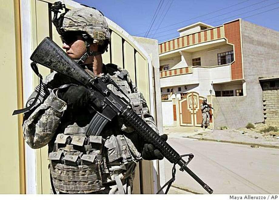 A U.S. Army soldier from Ironhawk Troop, 3rd Squadron, 3rd Armored Cavalry Regiment, patrols in Mosul, 360 kilometers (224 miles) northwest of Baghdad, Iraq, Friday, Oct. 3, 2008. (AP Photo/Maya Alleruzzo) Photo: Maya Alleruzzo, AP