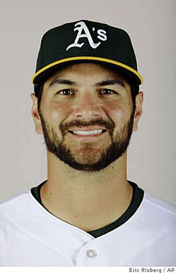 ** FILE ** This is a 2009 file photo of Eric Chavez of the Oakland Athletics baseball team. Chavez's surgically repaired right shoulder bothered him when he was hitting during Oakland's exhibition game Sunday March 8, 2009, forcing the Athletics to push back his spring debut in the field. (AP Photo/Eric Risberg, File) Photo: Eric Risberg, AP