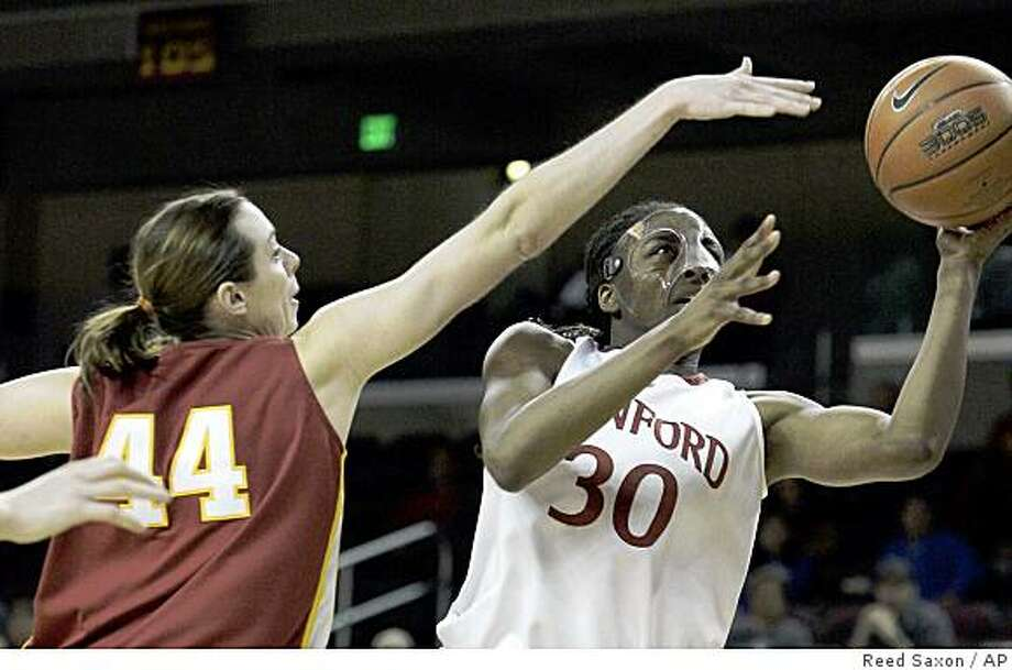 Stanford forward Nnemkadi Ogwumike (30) shoots as Southern California center Nadia Parker defends in the first half of the championship game of the NCAA Pac-10 college women's basketball tournament in Los Angeles Sunday, March 15, 2009.  (AP Photo/Reed Saxon) Photo: Reed Saxon, AP