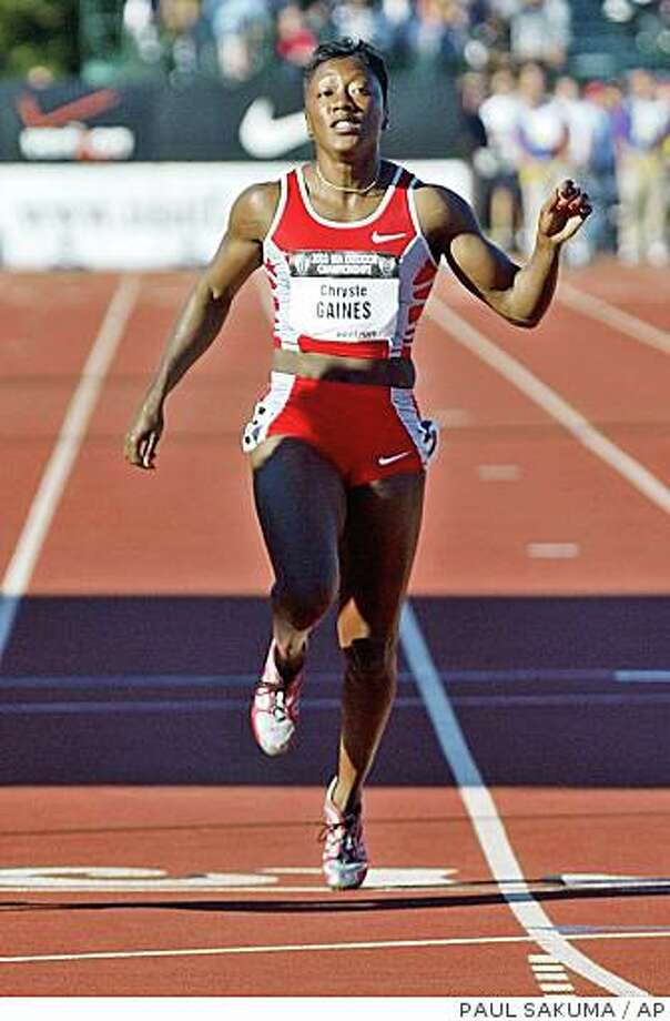 Chryste Gaines competes in the semifinals of the 100 meters at the U.S. track and field championships Friday, June 20, 2003 at Stanford. Photo: PAUL SAKUMA, AP