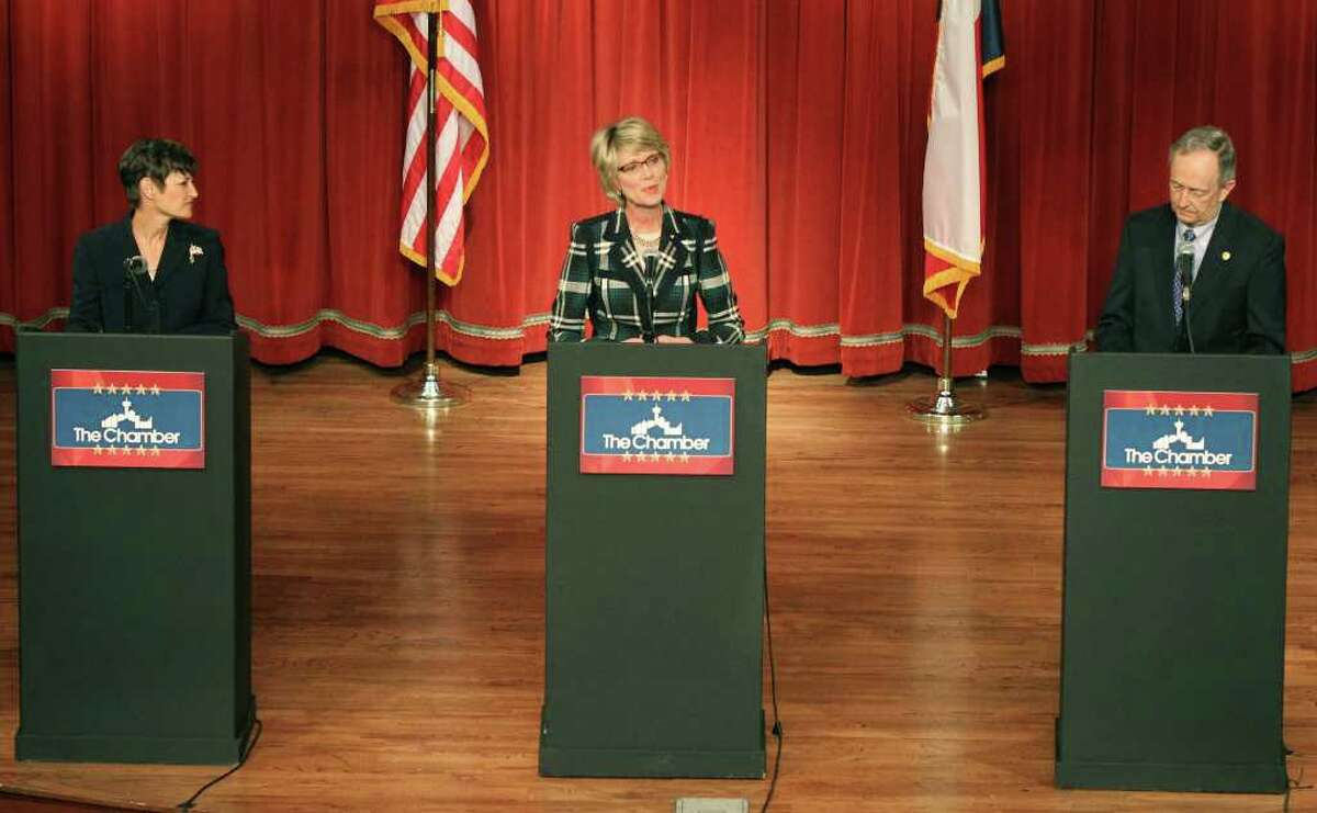 Elizabeth Ames Jones, Chairman of the Texas Railroad Commission (center), speaks during The Greater San Antonio Chamber of Commerce's State Debate-Texas Senate District 25 at the Pearl Stable Wednesday, Feb. 8, 2012. On the left is candidate Dr. Donna Campbell and on the right is incumbent Senator Jeff Wentworth. All three are running as Republican candidates for District 25 of the Texas Senate.
