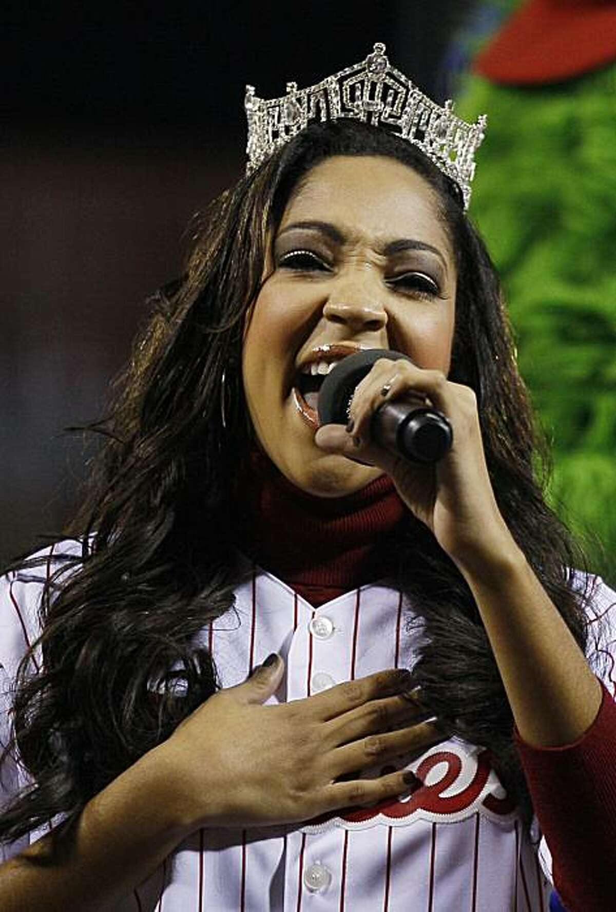 Miss America Caressa Cameron sings the national anthem before Game 6 of baseball's National League Championship Series between the Philadelphia Phillies and the San Francisco Giants Saturday, Oct. 23, 2010, in Philadelphia.
